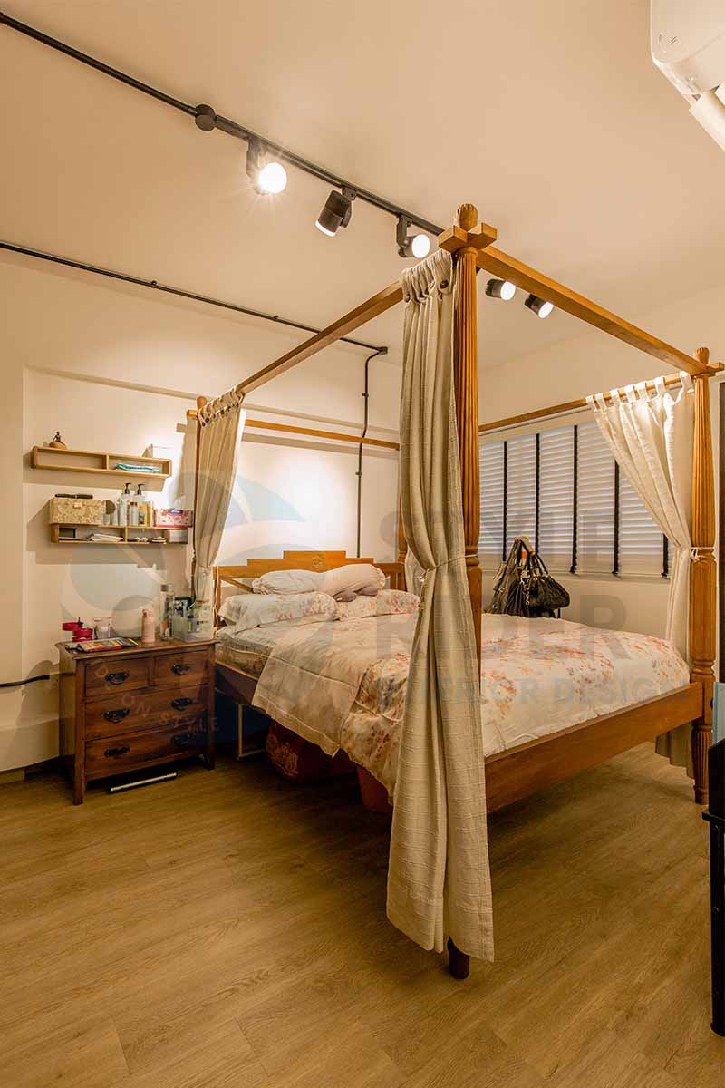 industrial design bedroom with wooden bed frame