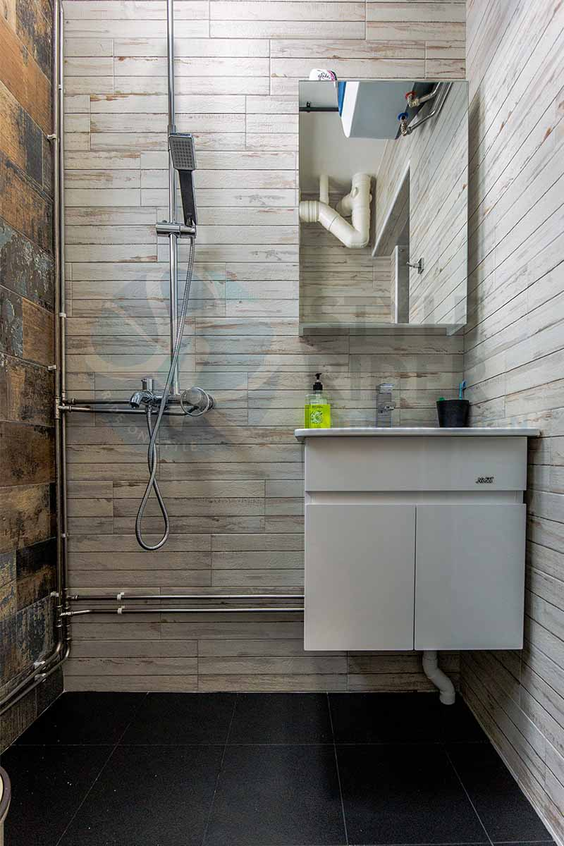 industrial design toilet with wooden tiles and metal piping